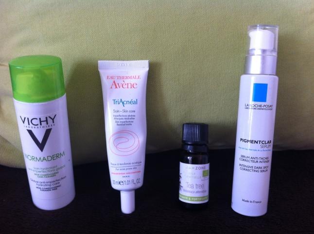 Crèmes et huile essentielle contre l'acné
